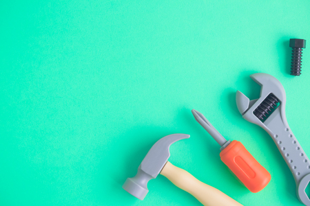 Plastic carpentry tools minimal creative background. Space for copy,