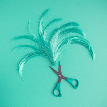 Wig and scissors turquoise tone hairstyle background.