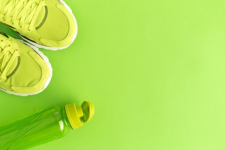 Flat lay of sport exercise equipment green minimal creative concept. Space for copy. Stock Photo