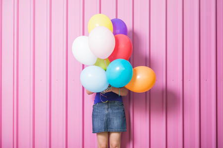 Young woman with colorful balloons on the street summer concept. Reklamní fotografie