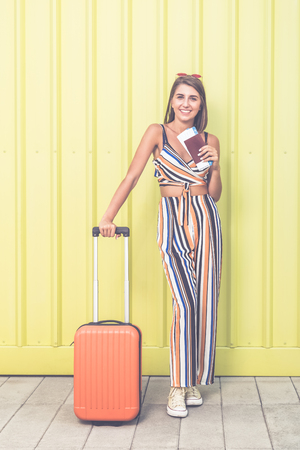 Cheerful woman ready to travel. Summer vacation concept.
