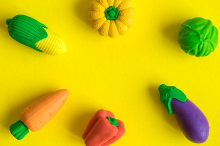 Rubber vegetables on yellow background minimal creative concept.