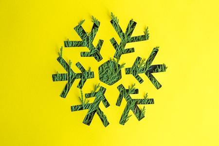 Christmas tree snowflake on yellow background minimal creative concept.