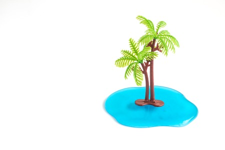 Palm tree and ocean tropical minimal creative concept. Space for copy. 版權商用圖片