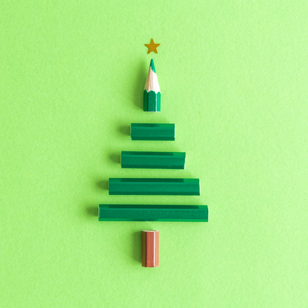 Flat lay of pencil in form of Christmas tree abstract on pastel green background. 版權商用圖片