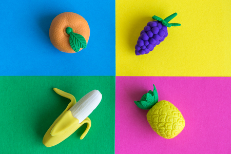 Rubber fruits on colorful background minimal creative concept.