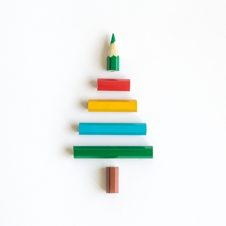 Christmas tree made of colorful pencils minimal holiday creative concept.
