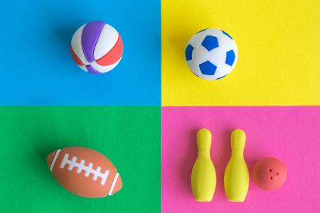 Sport equipment toys on colorful background minimal creative concept. 版權商用圖片