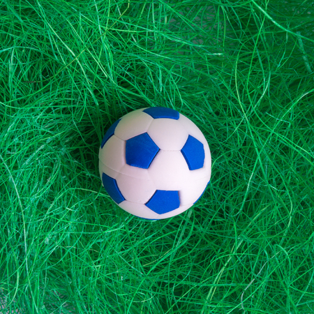 Soccer ball in grass minimal sport creative concept.