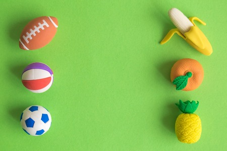 Sport and tropical fruits on green background minimal creative concept. Space for copy. 版權商用圖片