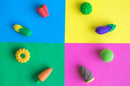 Different rubber vegetables on colorful background minimal creative concept.