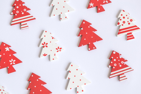 Flat lay of wooden christmas trees pattern on white background minimal creative concept. 版權商用圖片