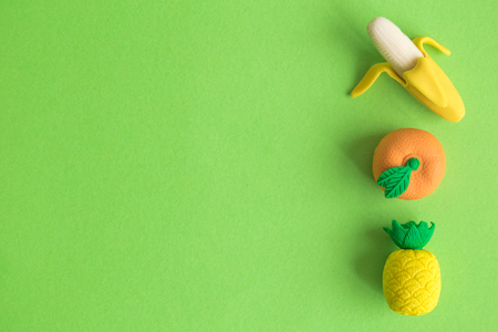 Tropical rubber fruits on pastel green background minimal creative concept. Space for copy.