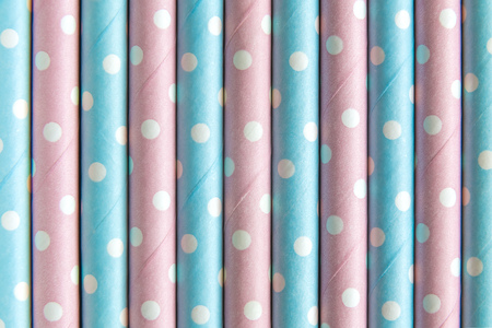 Pastel colored polka design drinking straws background abstract. 版權商用圖片