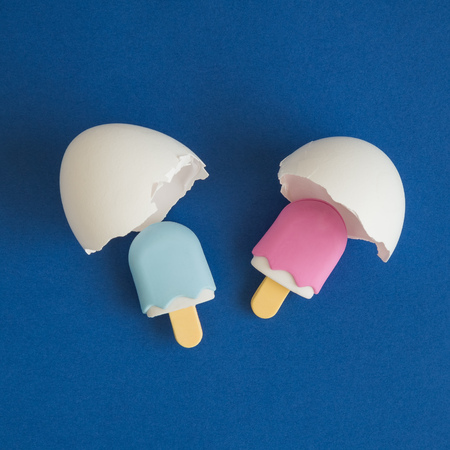 Flat lay of ice cream hatching from egg shell minimal easter creative concept.