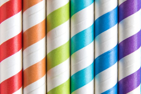Colorful striped drinking straws background abstract. Summer and beverage concept.