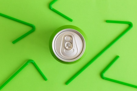 Flat lay of aluminum can and drinking straws minimal beverage and recycle creative concepts.