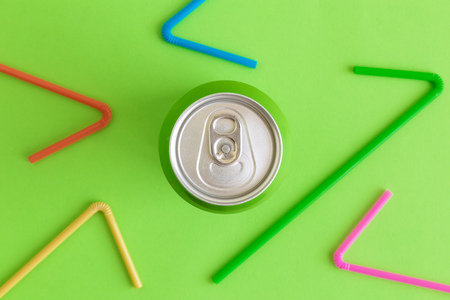 Flat lay of aluminum can and colorful drinking straws minimal beverage and recycle creative concepts.