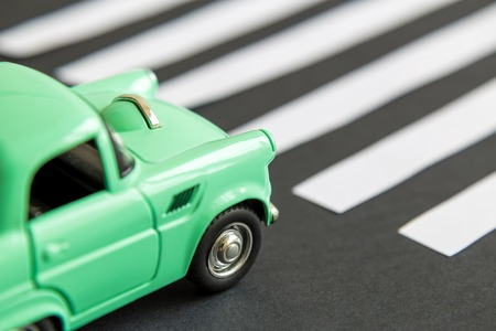 Close up of car toy on pedestrian crossing minimal creative concept. Reklamní fotografie