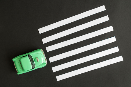 Overhead view of small car and pedestrian pathway on a street crossing abstract. Reklamní fotografie