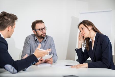 Dissatisfied businesswoman on a meeting. Foto de archivo - 122337572
