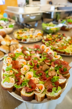Catering buffet table with canapes 스톡 콘텐츠