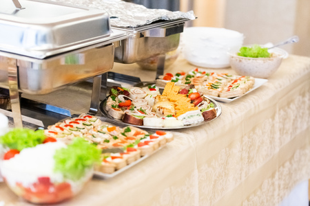 Catering served table with delicious food snacks. 스톡 콘텐츠