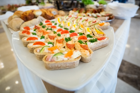 Beautifully decorated catering banquet table with different food snacks and appetizers 스톡 콘텐츠