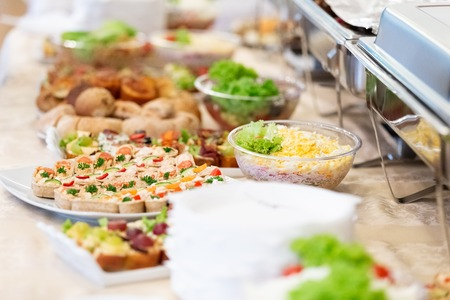 Canapes and salads on buffet table. 스톡 콘텐츠