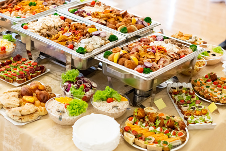 Catering buffet with food on table.