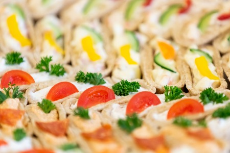 Beautifully decorated catering banquet plate with different food snacks and appetizers. Reklamní fotografie - 124961397