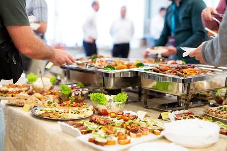 People enjoying buffet meal.