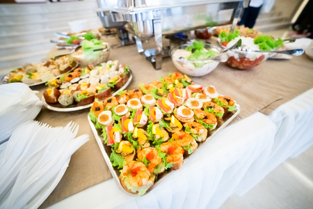 Appetizer canape with shrimp and mussels on buffet table.