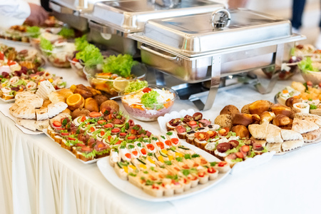 Catering buffet table with canapes, salads and bread. 스톡 콘텐츠