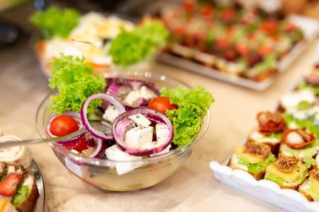 Greek salad served on table.