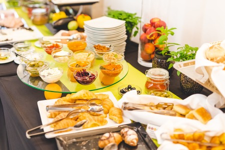 Breakfast buffet table concept with assorted food.