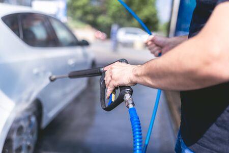Self car washing by using high pressure water.