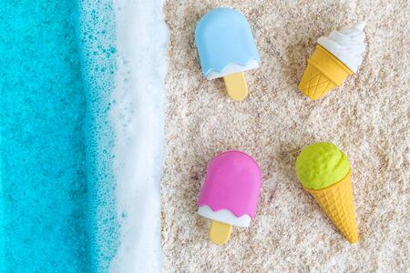 Minimal beach creative concept summer vacation with blue sea and ice cream.