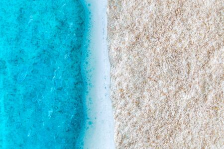 Minimal creative summer vacation concept with blue ocean and sandy beach. Space for copy. 스톡 콘텐츠