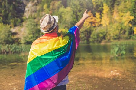 Man with lgbt flag in nature. Human rights and freedom concepts.