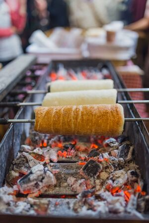 Close up of chimney cake preparing on grill. Banco de Imagens - 133162799