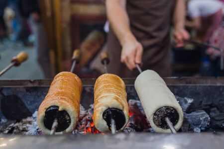 Preparation of the famous, traditional and delicious Hungarian Chimney Cake Banco de Imagens