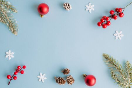 Christmas composition background decoration on pastel blue background. Space for copy.