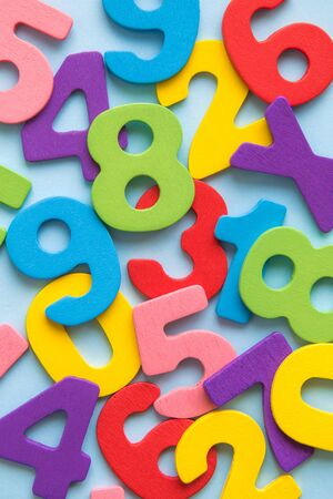 Close up of multicolored wooden numbers back to school abstract. Banco de Imagens