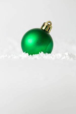 Christmas ball decoration on snow. Winter season and holiday concepts.