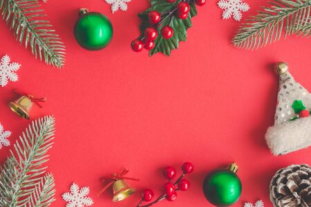 Christmas composition decoration on red background. Space for copy. Banco de Imagens