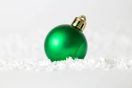 Creative layout of Christmas bauble decoration on snow. Holiday background. Space for copy. Banco de Imagens