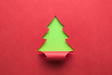 Christmas tree made of paper minimal creative winter holidays concept.