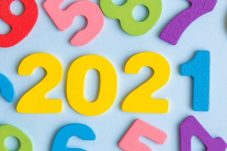 New year concept 2021 made of wooden numbers on pastel blue background. Banco de Imagens