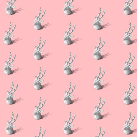 Reindeer pattern on pastel rose background minimal christmas and winter season creative concept.